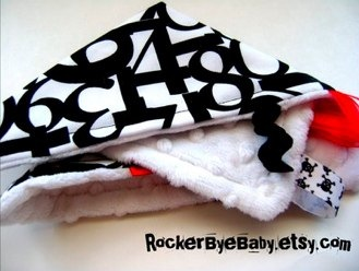 Punk Rock Numbers First Sight Skullie sensory blanket with ribbons and tags black and white with white minky dot