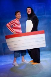 The Boy and the penguin take to the sea together in their boat