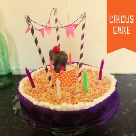 Circus themed birthday cake with elephant and washi tape bunting