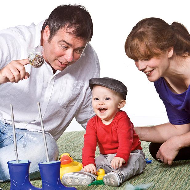 Mum, Dad and baby enjoying BabyO